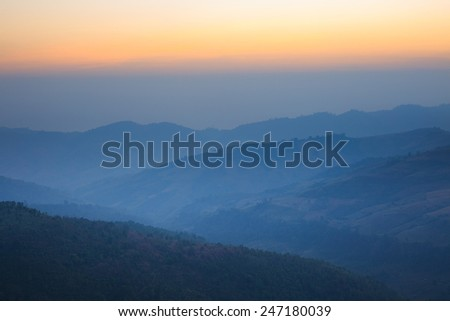 Scenic view of the winter mountains in sunset time.