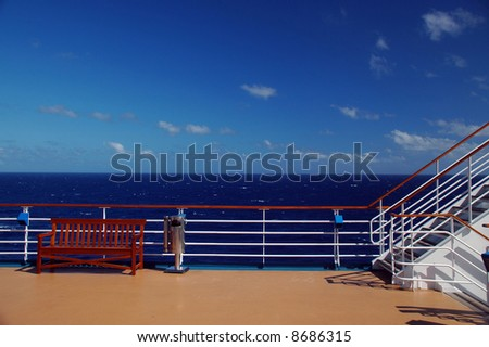 Scenic view of top deck on cruise ship with caribbean in the background - stock photo