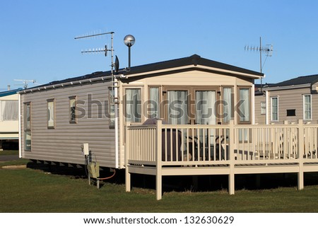 Scenic view of trailers in caravan park with blue sky background. - stock photo