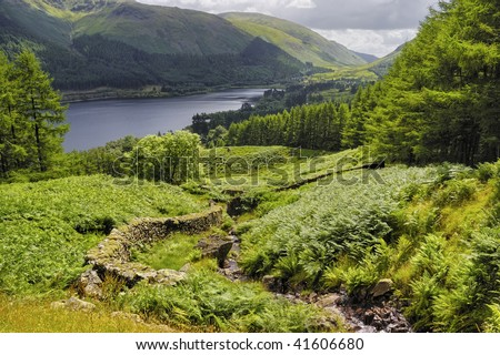 Scenic view of  Ullswater lake with track in foreground, Lake District National Park, Cumbria, England - stock photo