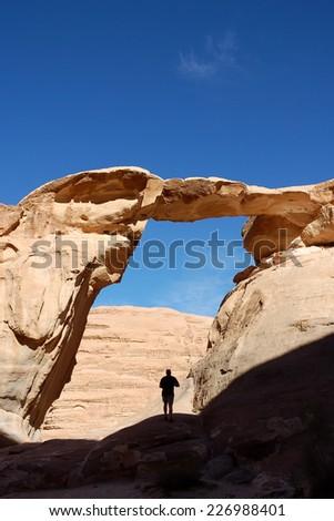 Scenic view of Um Fruth rock arch in Wadi Rum desert, Jordan. - stock photo