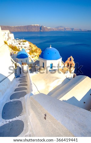 Scenic view of white houses, stairs and blue domes in Santorini, Greece - stock photo