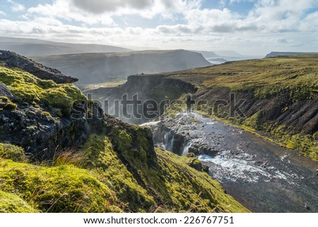 Scenic view of wild Icelandic landscape with river. - stock photo