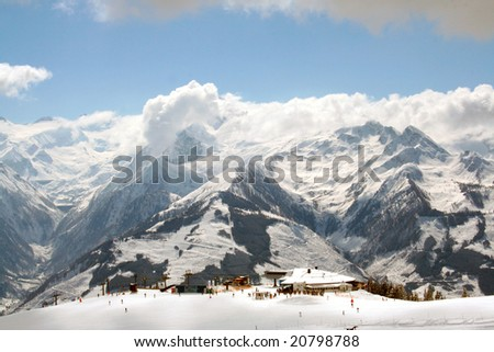 Scenic view of winters landscape of Swiss Alps mountains by ski station, Switzerland.
