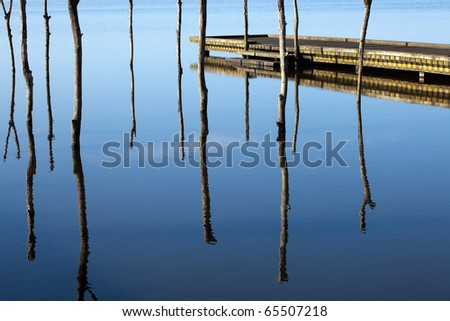 Scenic view on a lake with jetty in Aquitaine, France - stock photo