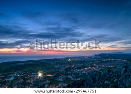 Scenic view over small town in Portugal, Atlantic Ocean and sunset sky in the evening - stock photo