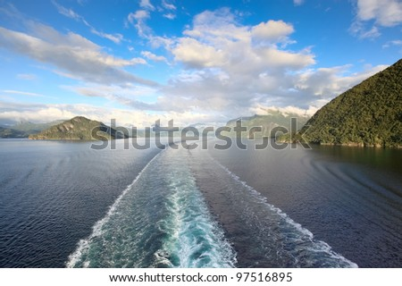 Scenic views of Storfjord (Norway) from deck of cruise ship - stock photo