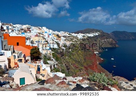 Scenic village of Oia and the volcanic caldera of Santorini island  in Cyclades, Greece - stock photo