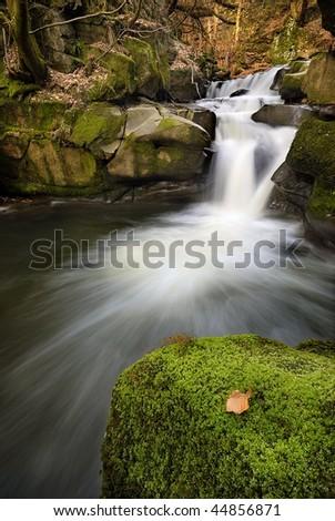 Scenic waterfall - stock photo