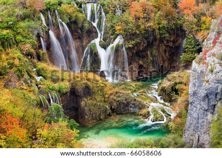 Scenic waterfalls in a beautiful picturesque autumn scenery of the Plitvice Lakes National Park in Croatia - stock photo