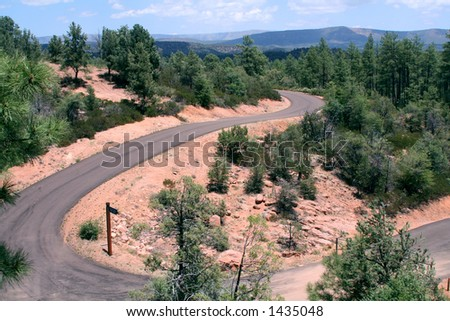 Scenic, winding mountain road in the desert - stock photo