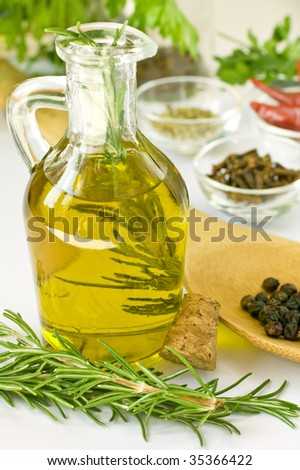 Scented oil with rosmarin and other spices - stock photo