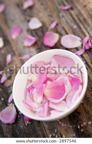 Scented rose petals in a bowl - shallow depth of field - stock photo