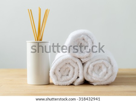 Scented woods and white towel for spa - stock photo