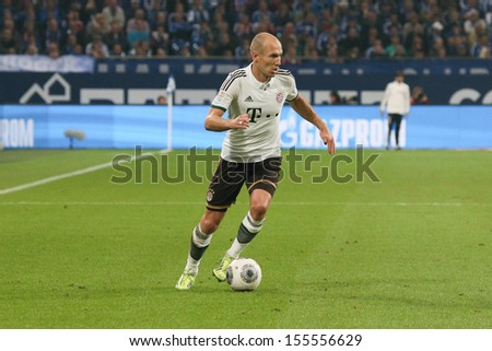 SCHALKE, GERMANY - SEP 21: Arjen Robben (FC Bayern) during a Bundesliga match between FC Schalke 04 & FC Bayern Munich, final score 0-4, on September 21, 2013, in Schalke, Germany. - stock photo