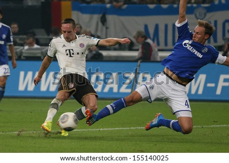 SCHALKE, GERMANY - SEP 21:B. Hoewedes (Schalke) and F. Ribery (Bayern) during a Bundesliga match between FC Schalke 04 & FC Bayern Munich, final score 0-4, on September 21, 2013, in Schalke, Germany.