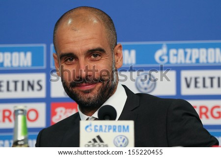 SCHALKE, GERMANY - SEP 21: Coach Josep Pep Guardiola (FC Bayern Munich) after a Bundesliga match between FC Schalke 04 & FC Bayern Munich, final score 0-4, on September 21, 2013, in Schalke, Germany. - stock photo
