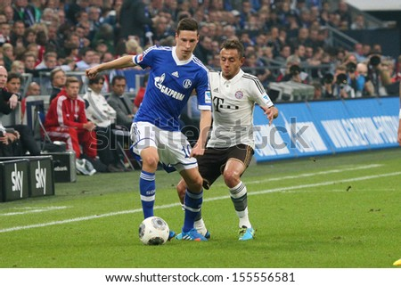 SCHALKE, GERMANY - SEP 21: Julian Draxler (Schalke 04) vs. Rafinha (FC Bayern) during a match between FC Schalke 04 & FC Bayern Munich, final score 0-4, on September 21, 2013, in Schalke, Germany. - stock photo