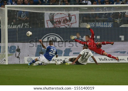 SCHALKE, GERMANY - SEP 21: Manuel Neuer & Jerome Boateng (Bayern) & Adam Szalai (Schalke) during a Bundesliga match between FC Schalke 04 & FC Bayern Munich on September 21, 2013, in Schalke, Germany. - stock photo