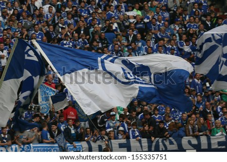 SCHALKE, GERMANY - SEP 21: Schalke 04 Fans celebrating during a Bundesliga match between FC Schalke 04 & FC Bayern Munich, final score 0-4, on September 21, 2013, in Schalke, Germany. - stock photo