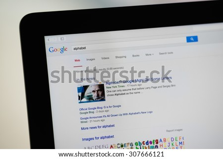 SCHARNHAUSEN, GERMANY - AUGUST 12, 2015: A Google search for alphabet in a web browser on a stylish computer monitor is displaying hits around the new company holding that Google founded several days - stock photo
