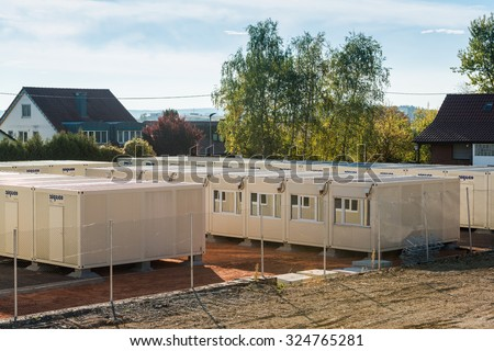 Scharnhausen, Germany - October 3, 2015: A temporary container city is set up on a former tennis ground in order to provide housing for the refugees that are currently fleeing to Germany, applying for - stock photo