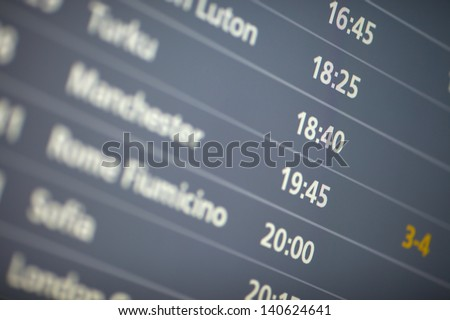 Schedule board at an airport - stock photo