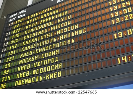 Schedule board of a railway station in Kyiv - stock photo