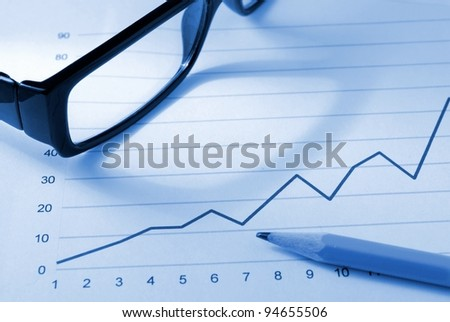 schedule, glasses and pen on the desk - stock photo