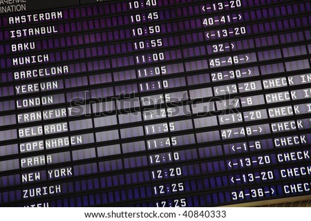 schedule of flights on an electronic board of the airport