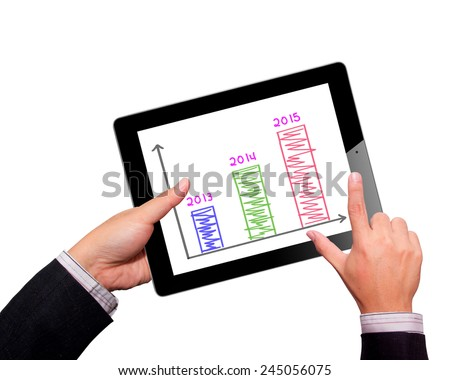 scheme growth profits on touchpad - stock photo