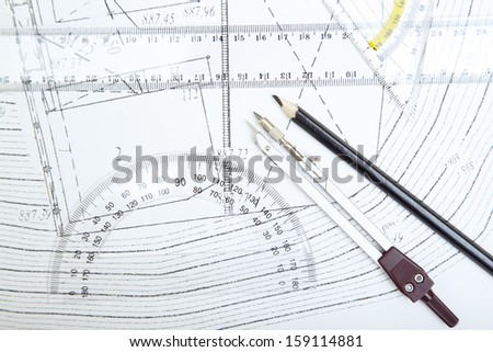 Scheme with compasses rulers and pencil. Close-up photo