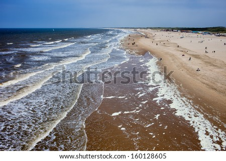 Scheveningen long, sandy beach by the North Sea, view from above, South Holland, the Netherlands. - stock photo