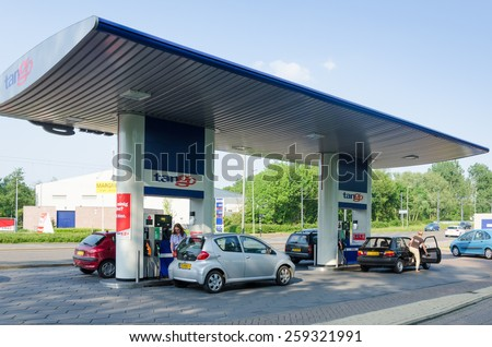 SCHIEDAM - APRIL 15: Tango gas station on April 15, 2014, Schiedam, The Netherlands. Tango gas is one of the big oil company, opens up stations all over Europe. - stock photo