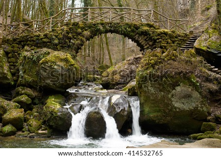 Schiessentumpel stone bridge and waterfall, Black Ernz River in Winter, Mullerthal Region, Luxembourg, Europe - stock photo