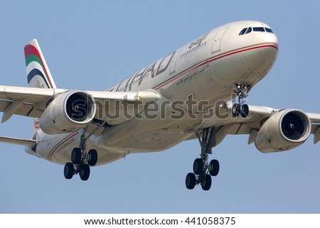 SCHIPHOL, AMSTERDAM, NETHERLANDS - APRIL 3, 2016: Airbus A330 of Etihad airlines landing at Schiphol international airport. - stock photo
