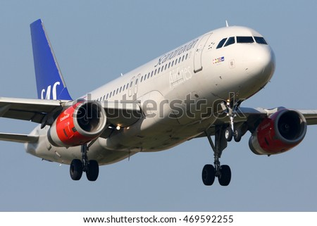 SCHIPHOL, AMSTERDAM, NETHERLANDS - APRIL 3, 2016: Airbus A320-232 OY-KAN of SAS Airlines landing at Schiphol international airport.