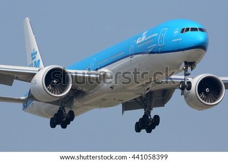 SCHIPHOL, AMSTERDAM, NETHERLANDS - APRIL 3, 2016: Boeing 777-300ER in new color scheme of KLM Royal Dutch Airlines landing at Schiphol international airport.