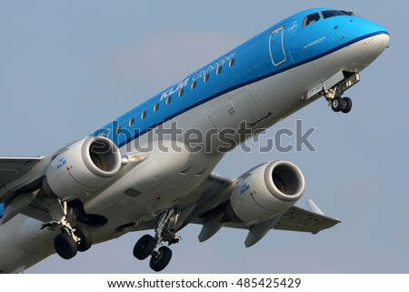 SCHIPHOL, AMSTERDAM, NETHERLANDS - APRIL 4, 2016: Embraer ERJ-190STD PH-EZX of KLM Cityhopper airlines taking off at Schiphol international airport.