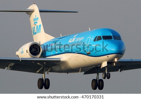 SCHIPHOL, AMSTERDAM, NETHERLANDS - APRIL 3, 2016: Fokker 70 PH-KZS KLM cityhopper Royal Dutch Airlines landing at Schiphol international airport.