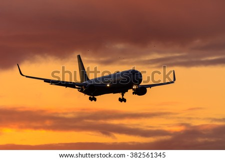 Schiphol, Noord-Holland/Netherlands - February 22-02-2016 - Plane from Delta airlines is landing at Schiphol airport.Photo taken during a sunrise at schiphol airport.