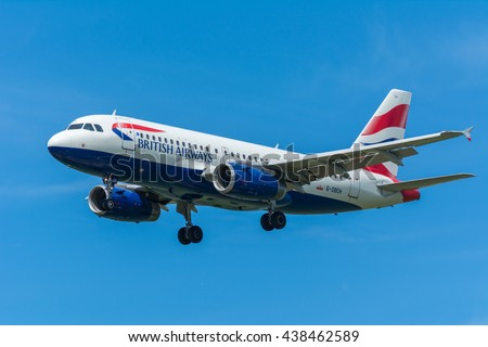 Schiphol, Noord-Holland/Netherlands -June 16-06-2016- Airplane British Airways Airbus A319-100 G-DBCH is flying to the runway. The Commercial jet aeroplane started the landing gear system for landing. - stock photo