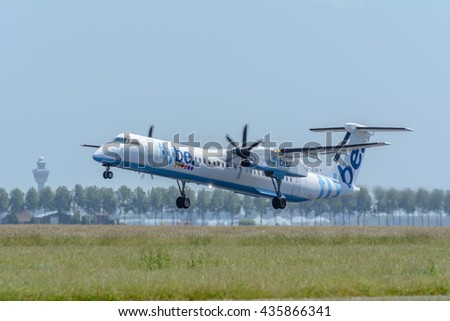 Schiphol, Noord-Holland/Netherlands - June 9-06-2016 - Airplane from Flybe G-JECK De Havilland Canada DHC-8-400 is taking off at Schiphol airport. The plane will fly to his final destination. - stock photo