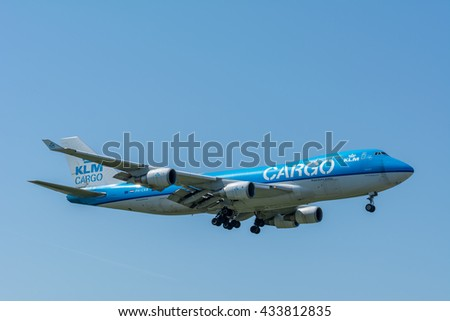 Schiphol, Noord-Holland/Netherlands - June 6-6-2016 - Airplane KLM Royal Dutch Airlines PH-CKB Boeing 747-400F is landing at Schiphol airport. The plane is flying to the runway. - stock photo