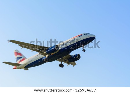 Schiphol, Noord-Holland/Netherlands- October 12-10-2015 -Plane from British Airways G-EQYK is preparing for landing at Schiphol airport. Blue sky at the background sun behind the airplane. - stock photo