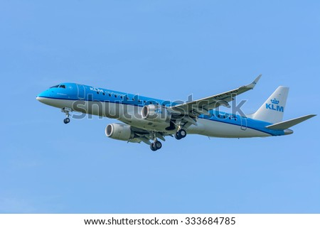 Schiphol, Noord-Holland/Netherlands- September 18-09-2015 -Plane from KLM Cityhopper  PH-EXD Embraer ERJ-190 is started landing at Schiphol Airport. Nice blue sky at the background of the Airplane.