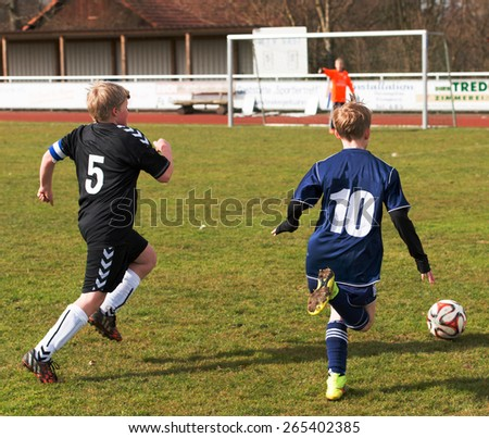 Schleswig Holstein - Tellingstedt, Germany â?? March 22, 2015: Teenager playing football in the club the MTV Tellingstedt - stock photo
