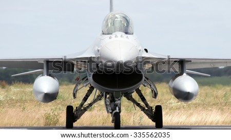 SCHLESWIG-JAGEL, GERMANY - JUN 23, 2014: F-16 on the runway during the NATO Tiger Meet at Schleswig-Jagel airbase. The Tiger Meet is to promote solidarity between NATO air forces - stock photo
