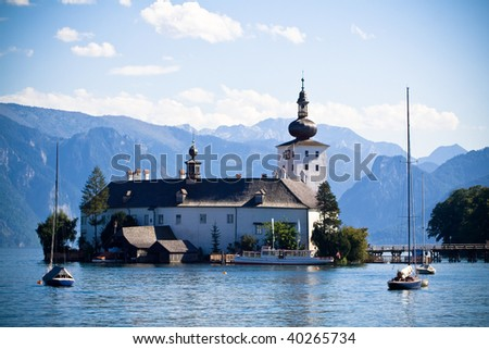 Schloss Ort - an Austrian castle situated in the Traunsee lake, near the Gmunden city. - stock photo