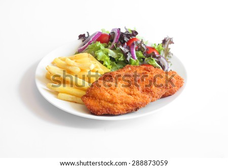 Schnitzel, French fries and vegetables - stock photo